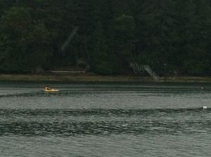 Noah kayaking in the rain at Port Browning